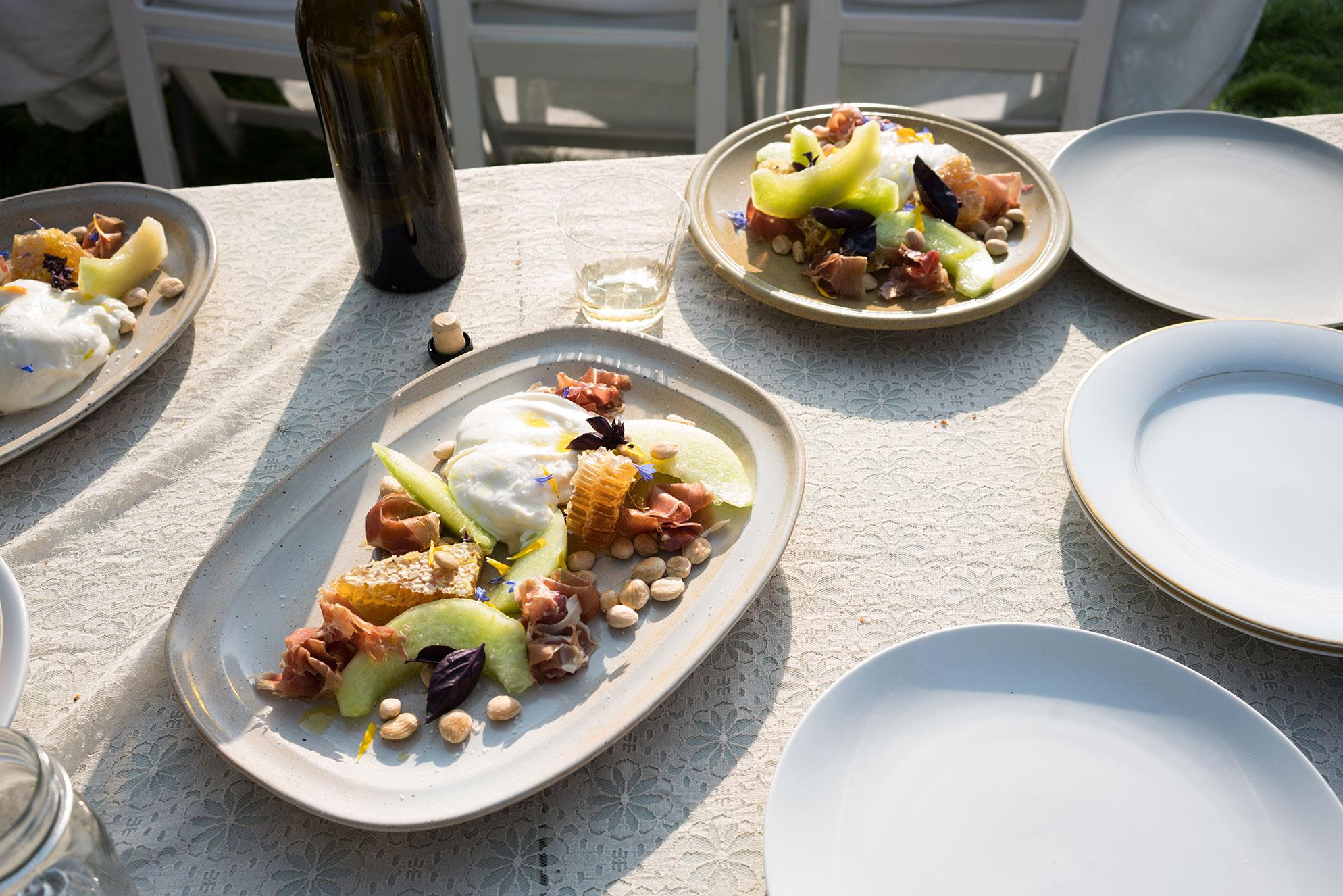 Burrata with honeycomb, melon, prosciutto and marcona almonds -