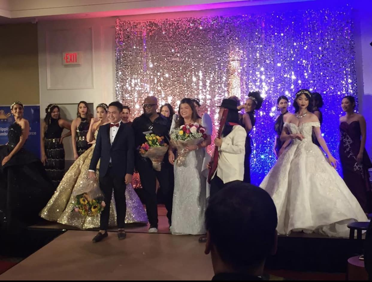 From left: Designer Djohn Clement, Director Tee Artis, PACC-DC President Cristina Sison, and musician Diwa de Leon receiving audience applause on stage with the models.