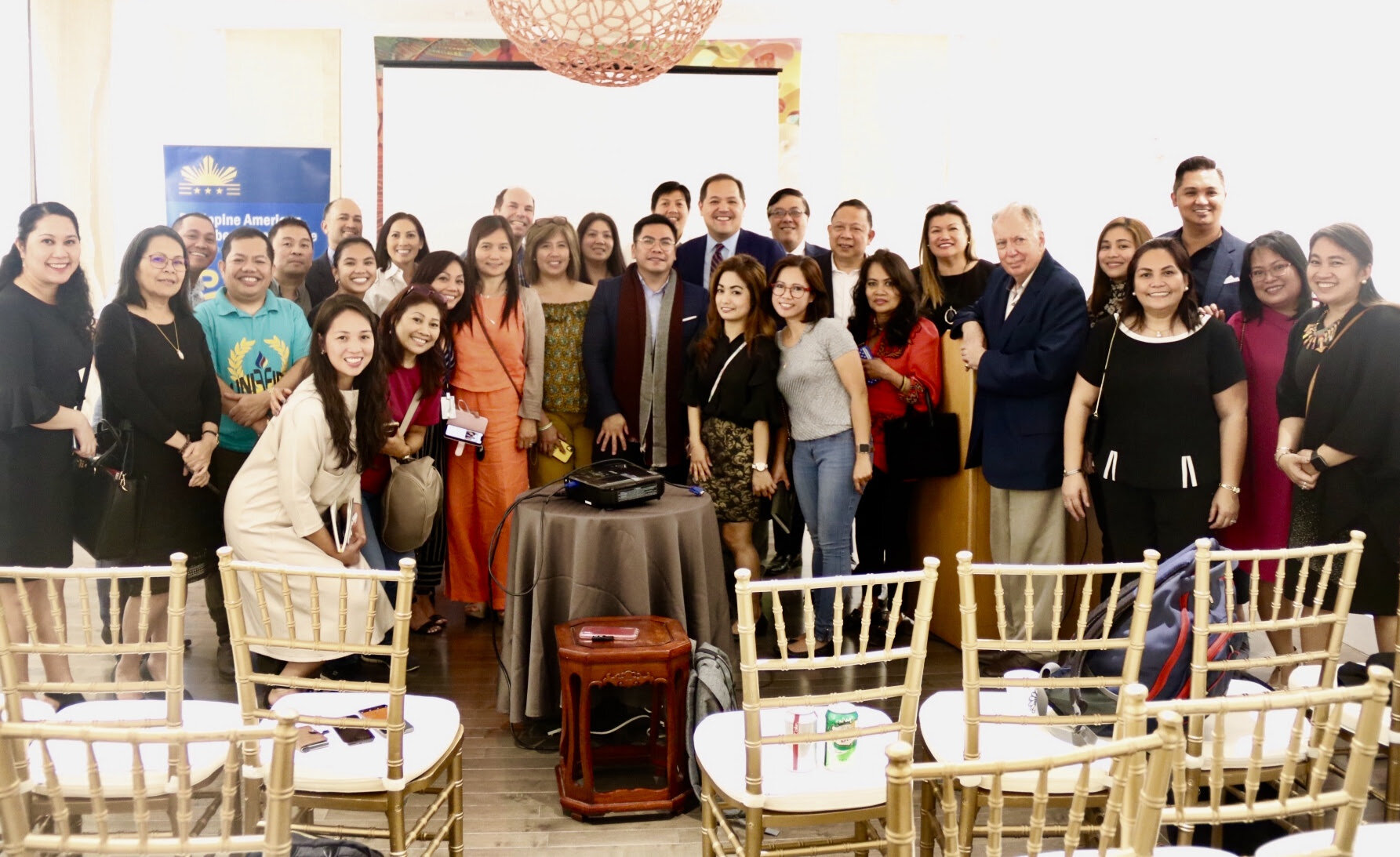 Group photo of Raymond Abrea with Commercial Counsellor Raymond Batac, Consul General Renato Pedro Villa, and attendees of the seminar