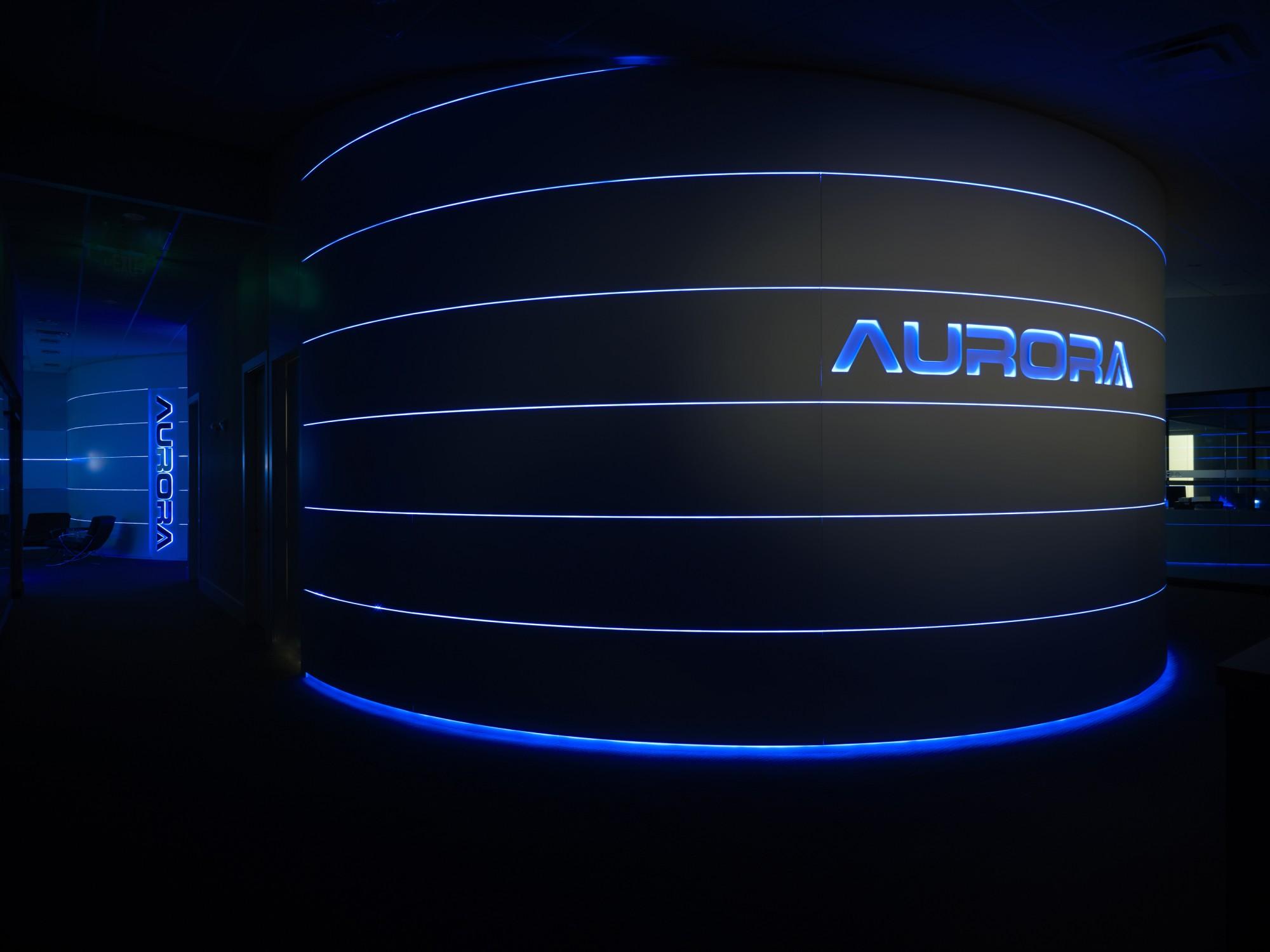 aurora_corporate_logowall_night.jpg