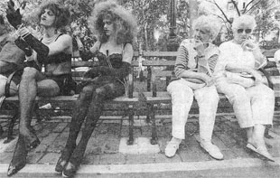 """PRIMPING: Two participants in the eighth annual Wigstock """"festival of love and wigs"""" in Tompkins Square Park ready themselves yesterday for a promenade while two local residents look on. photo: Misha Erwitt"""