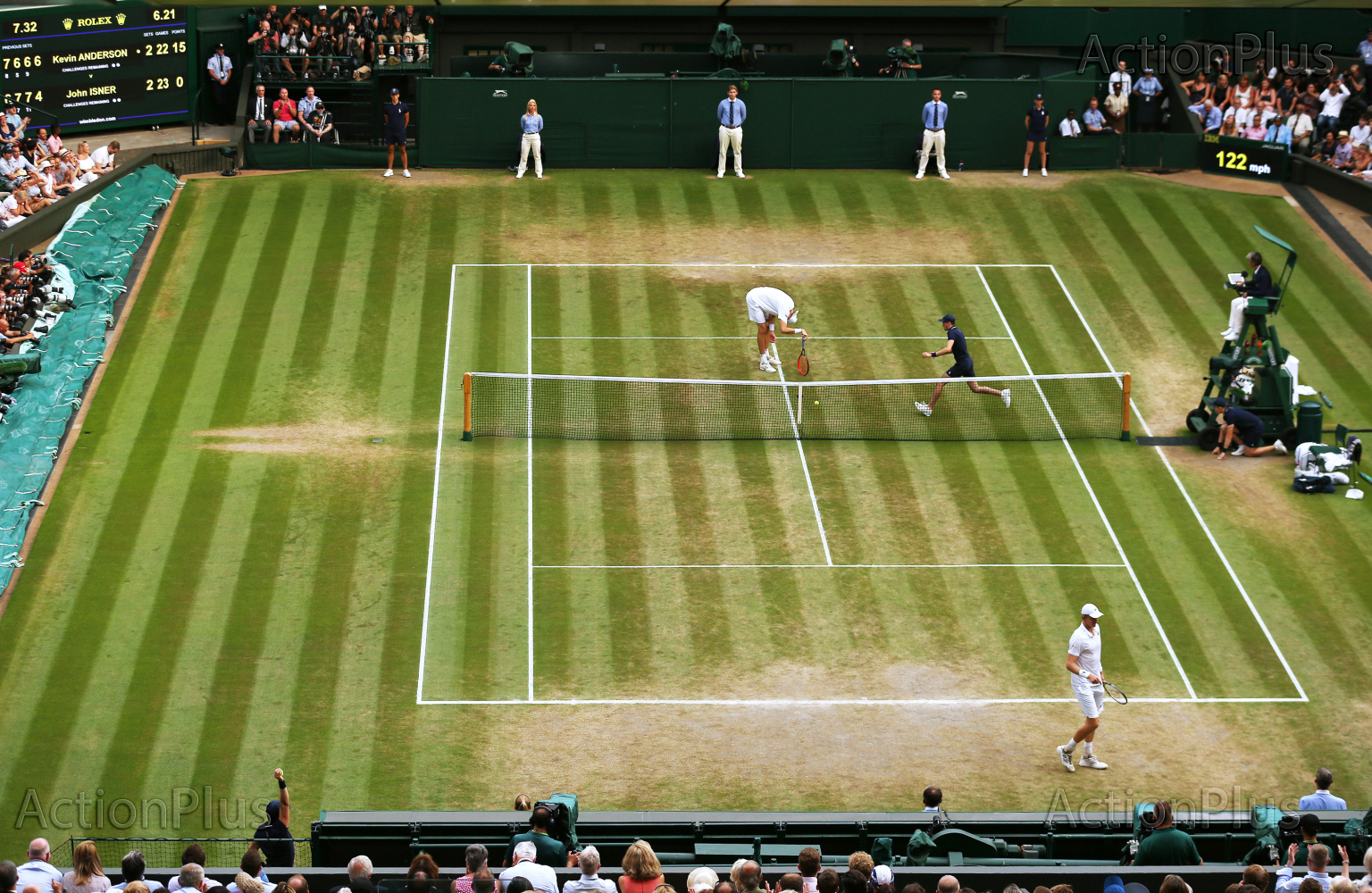 John Isner bent over exhausted at Centre Court against Kevin Anderson in what has become Wimbledon's 2nd longest match in history. Note the time at 6 hours and 21 minutes top right of the scoreboard.