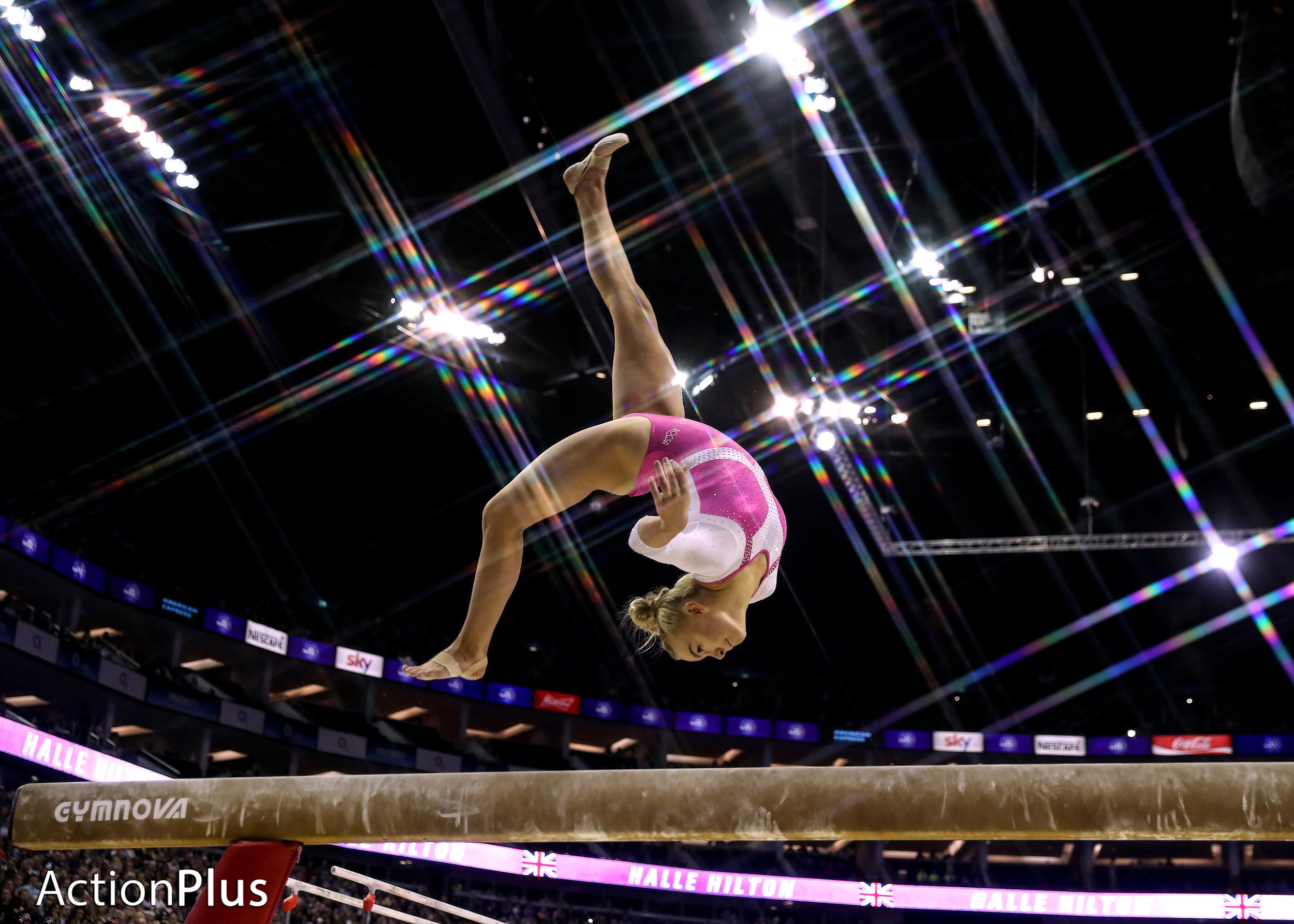 Halle Hilton of Great Britain performing on the beam.