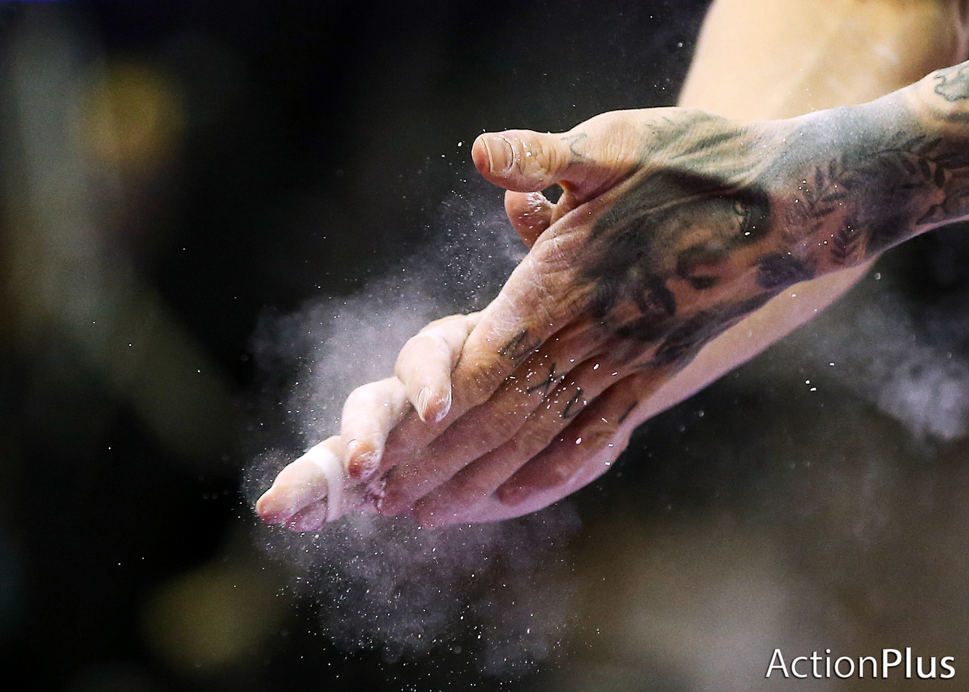 Marcel Nguyen of Germany rubbing chalk on his hands before performing on the men's pommel.