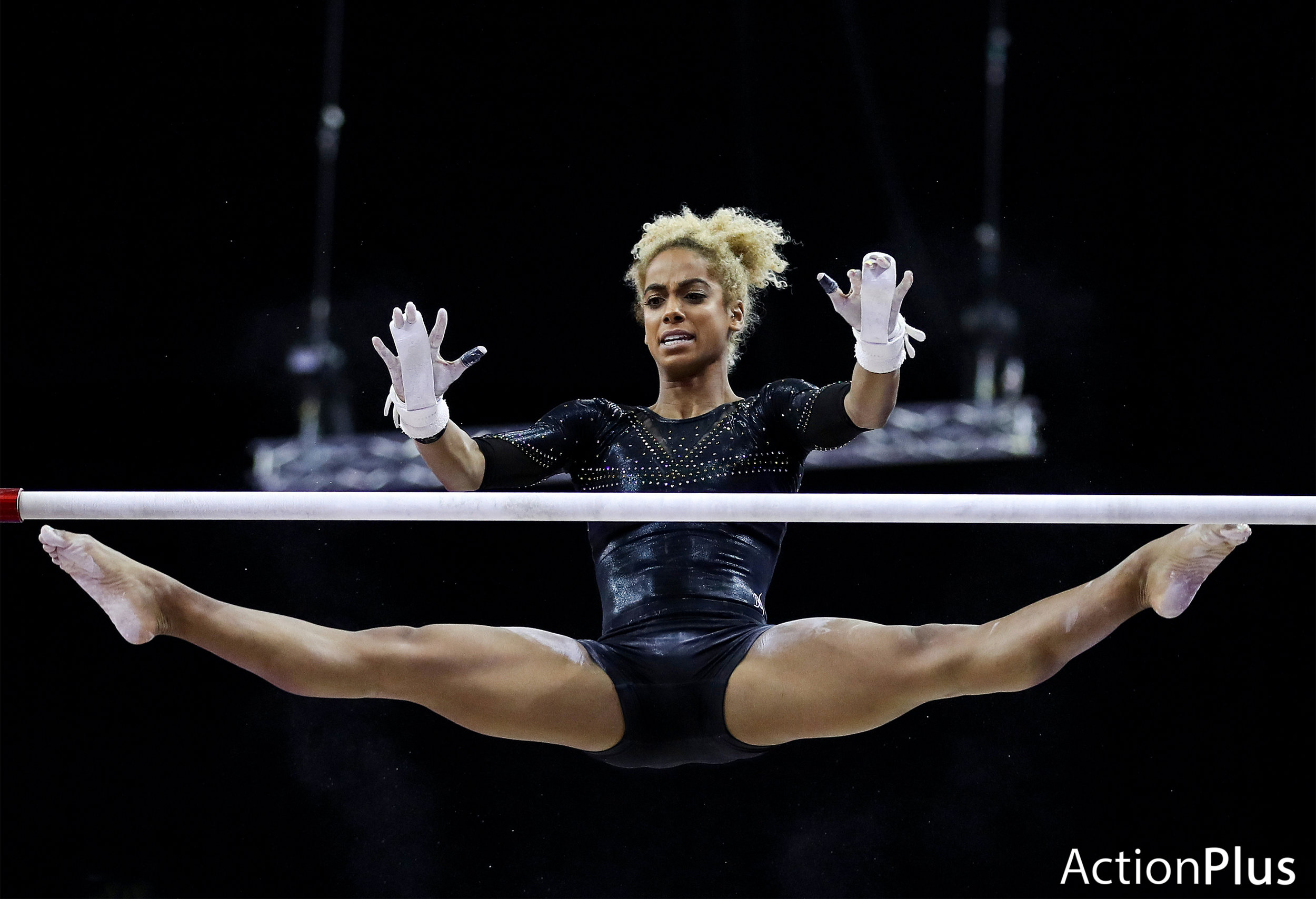 Danusia Francis of Jamaica performing on the women's uneven bars.