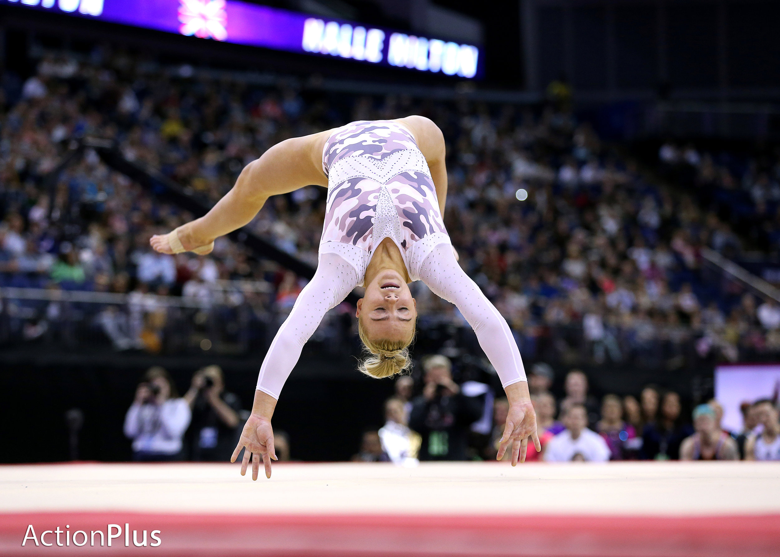 Halle Hilton of Great Britain performing the floor.