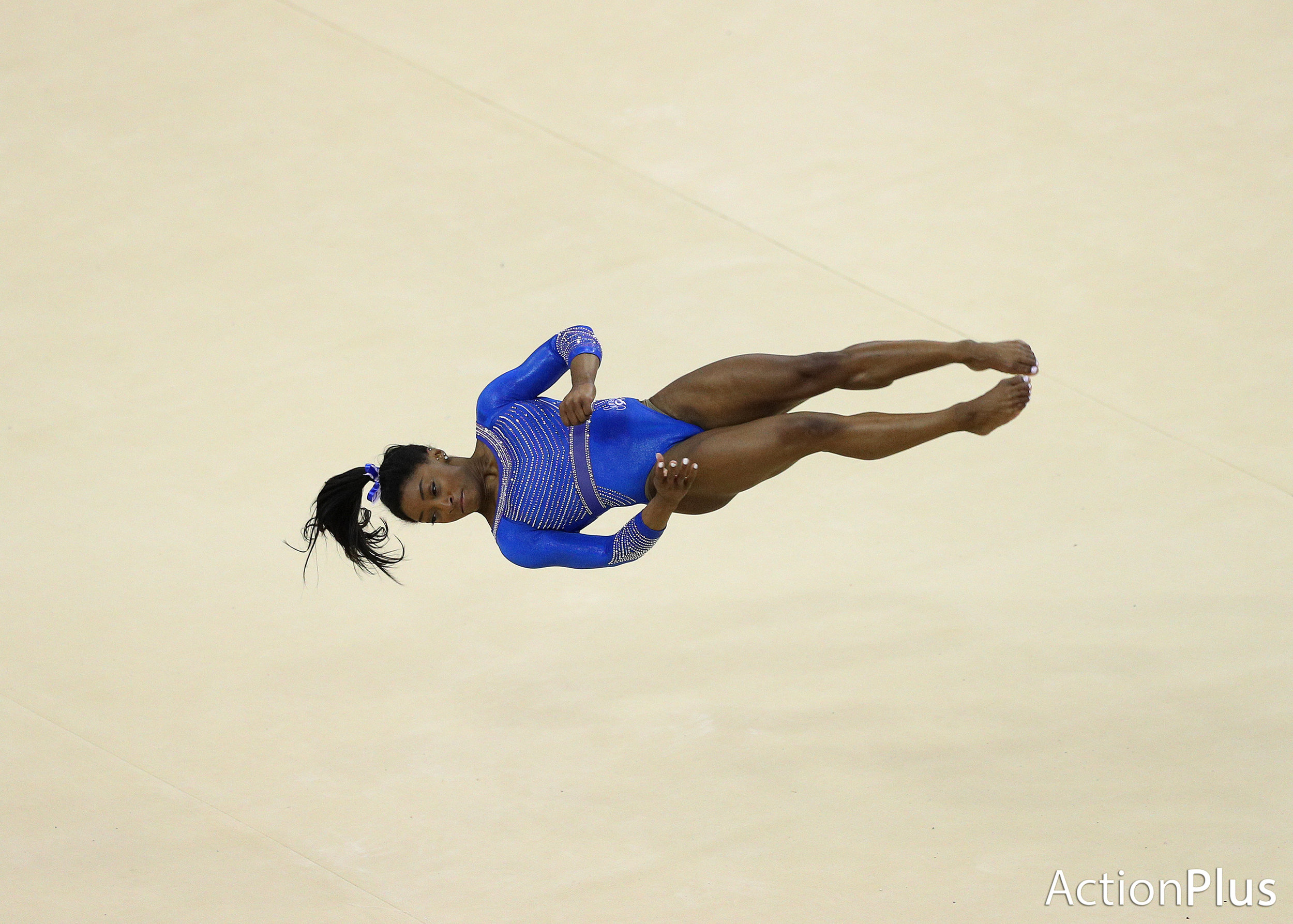 Simone Biles of USA performing on the floor.