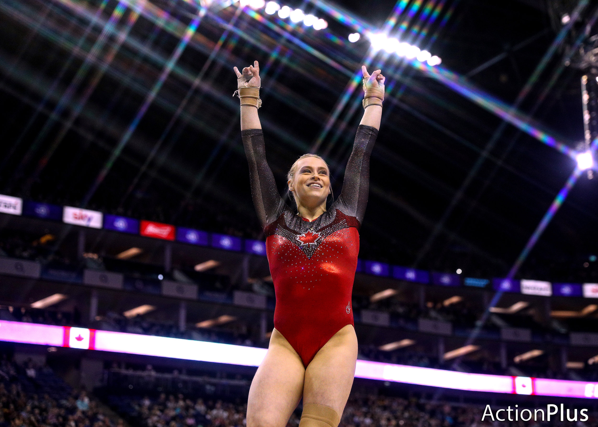 Ellie Black of Canada celebrates after performing on the vault.