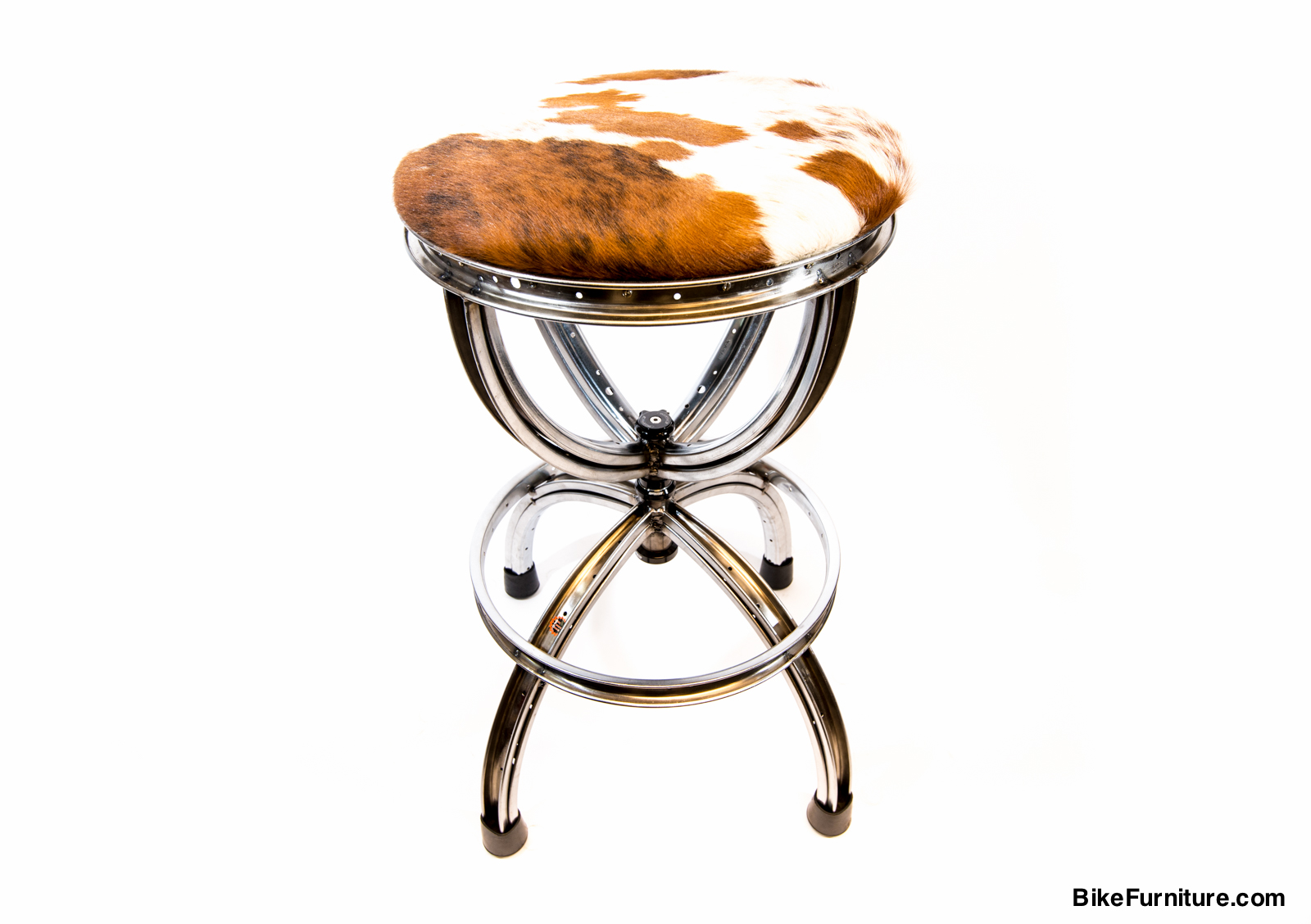 Crown swivel Barstool (shown with cowhide cushions)   Swivel mechanism is the headset bearing component   (available in colors) from a bicycle. Can also be made with a back.