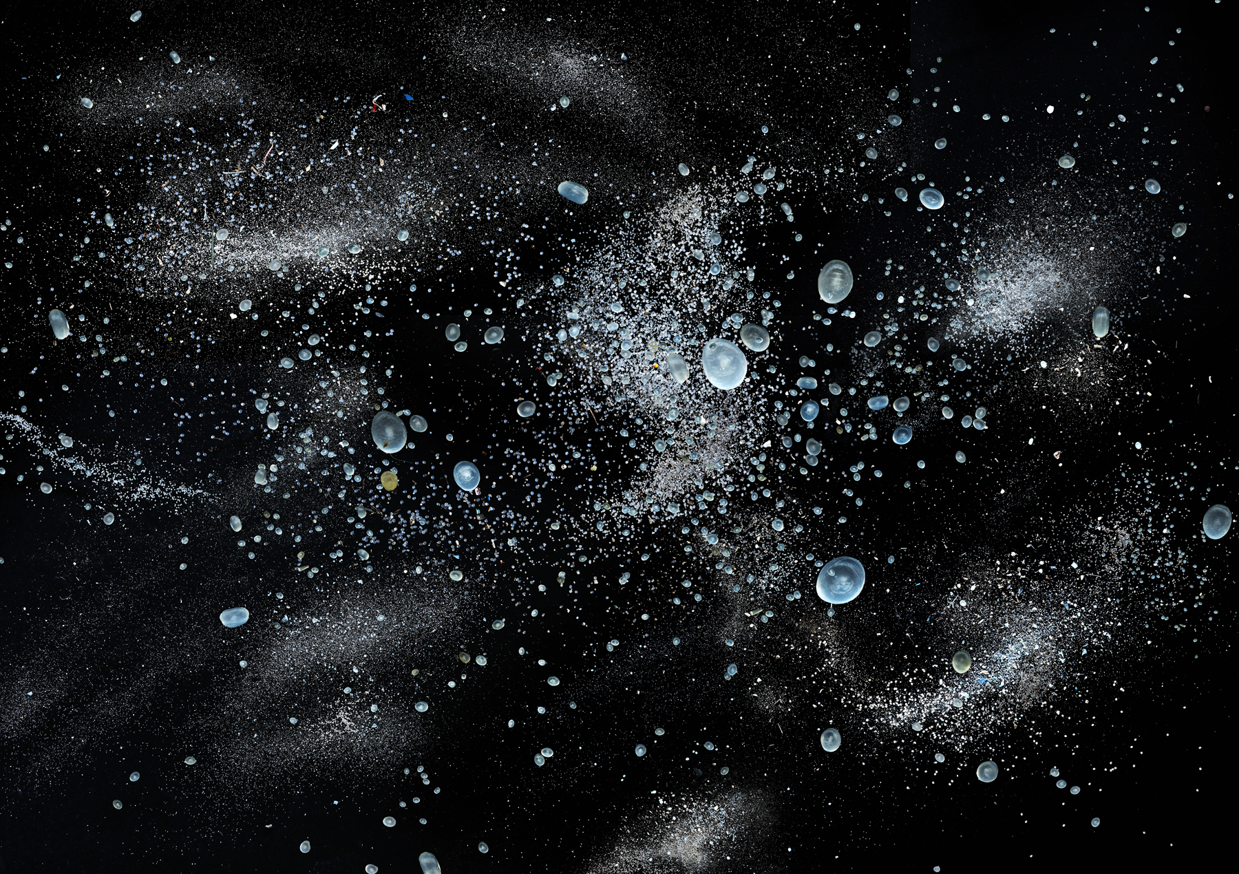 Hong Kong Soup: 1826 – Spilt  Representing 150 metric tons of nurdles (pre-production pellets), spilled from six cargo containers during Typhoon Vicente on July 23, 2012, adding to Hong Kong's waste issues in its seas and on its beaches. The image mirrors the night sky on the day of the spillage and depicts a collection recovered from six of the worst affected beaches soon after the incident  (from 'Hong Kong Soup:1826' series)