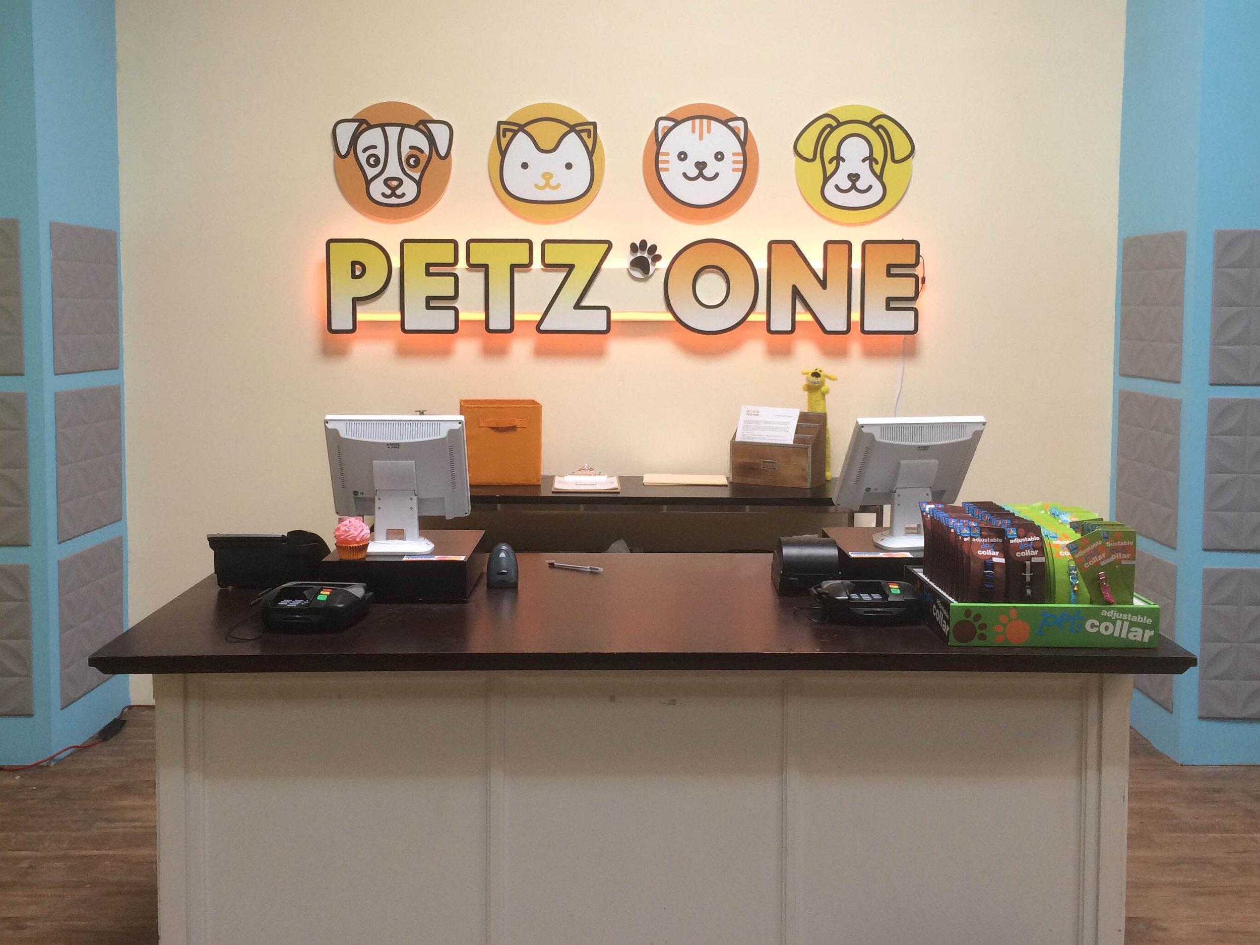 petz one logo on wall.jpg