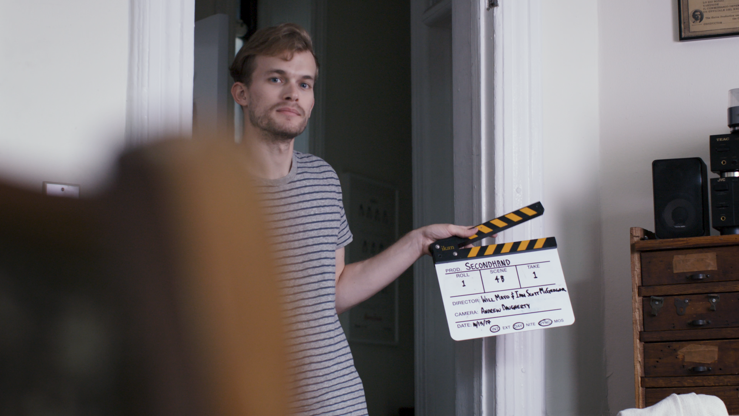 Will slating a shot on the set of the short film Secondhand.