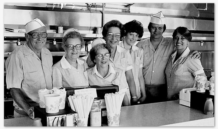 Store Manager, Carol Kelly (shown third from right), was hired in 1972 and is the current manager today.  She is also pictured above with her co-worker (and daughter) Victoria.