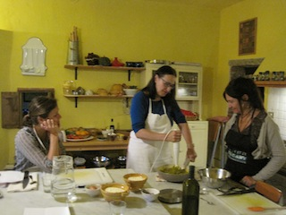 Candy purées the pumpkin for gnocchi, while Alli and Manul admire her style