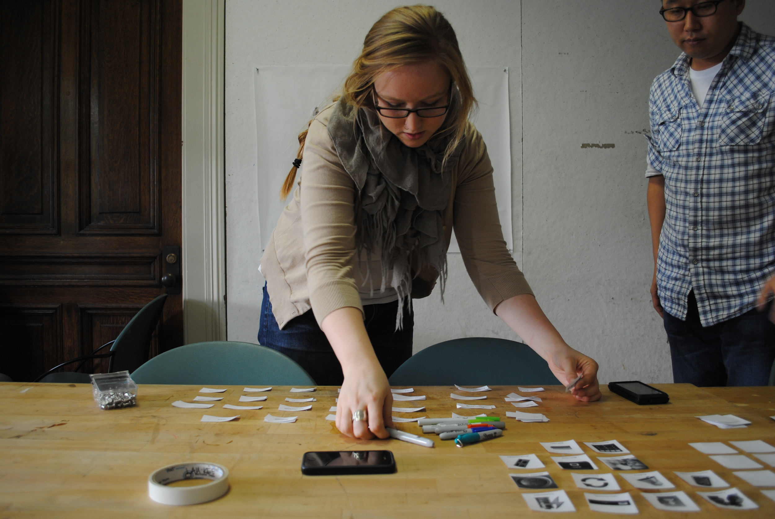 A participant uses make tools to create and communicate in the design process