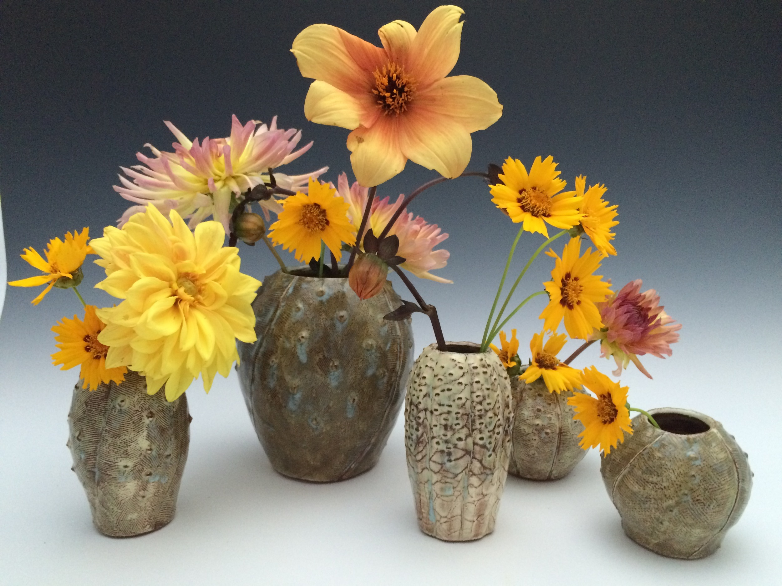 Here are some of my cactus vases looking good with some summer flowers.