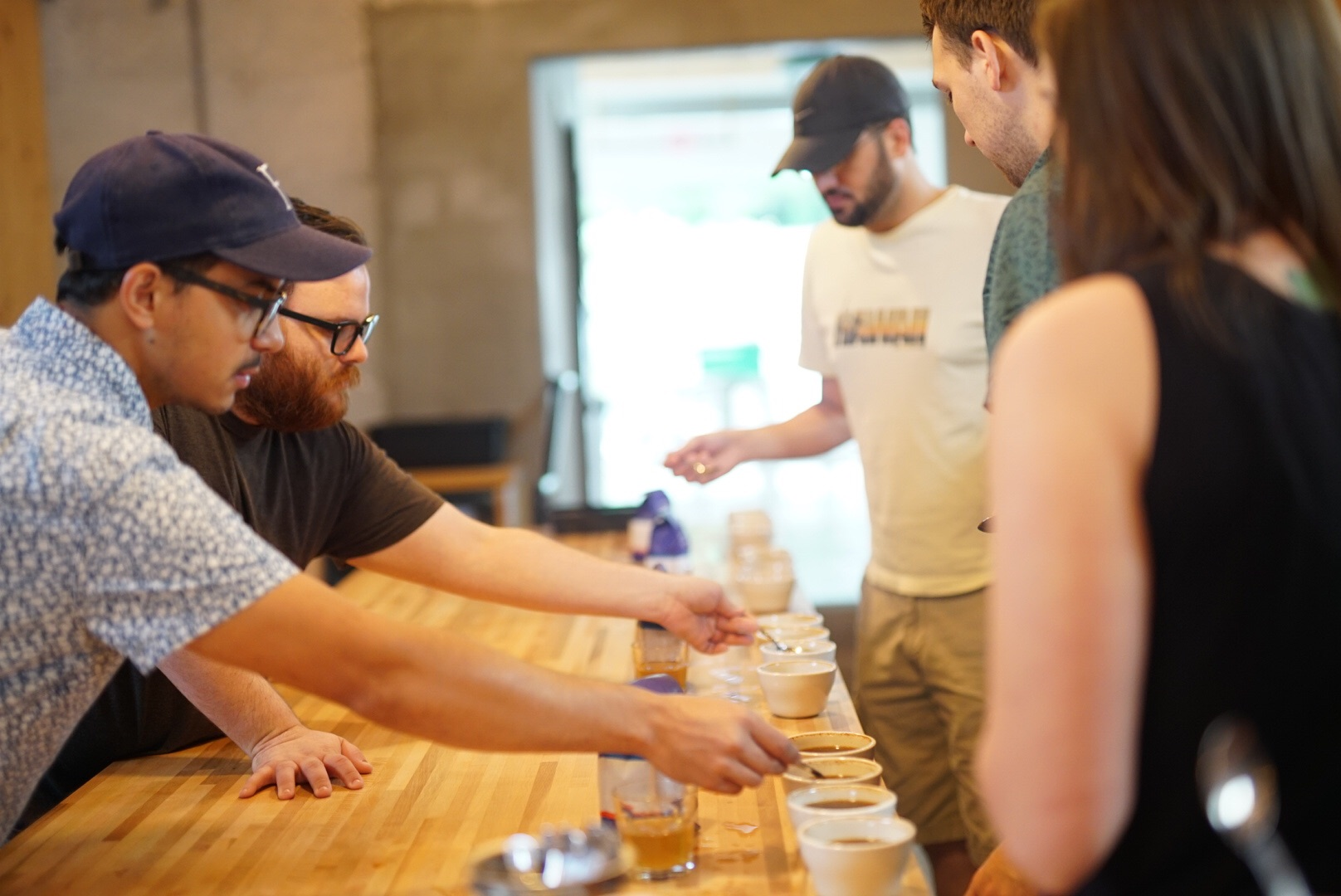 Diego (who, coincidentally is Guatemalan) guiding the coffee cupping at Charleston's branch of Counter Culture Coffee; Chris Nickels over the shoulder in green in a nice new birthday shirt.