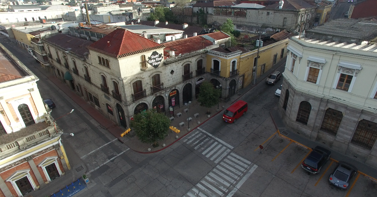 Tacorazon, from above, where the yellow building's and white building's corners meet.