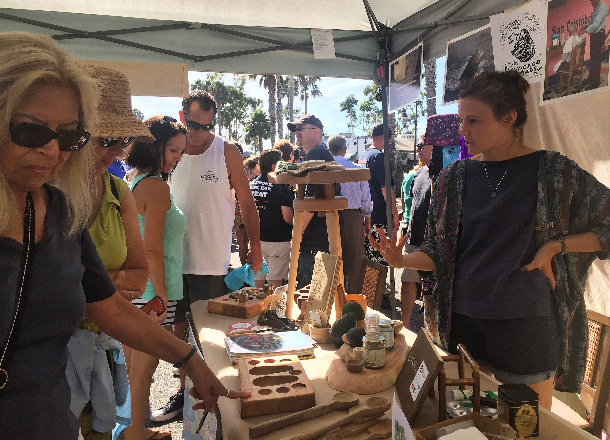 Amanda educating and selling at the 2016 Avocado Festival.