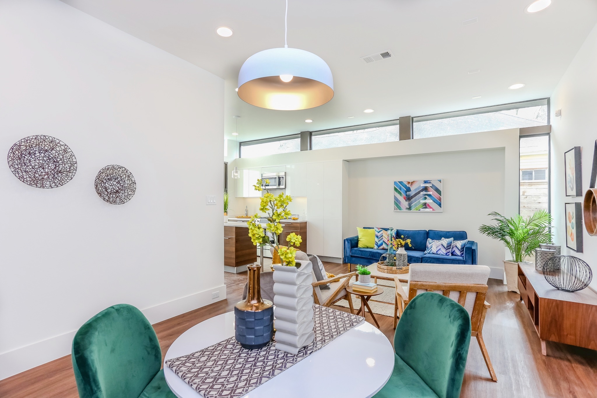 The distinctive dining area is anchored by a modern fixture and can accommodate the table of your choosing.