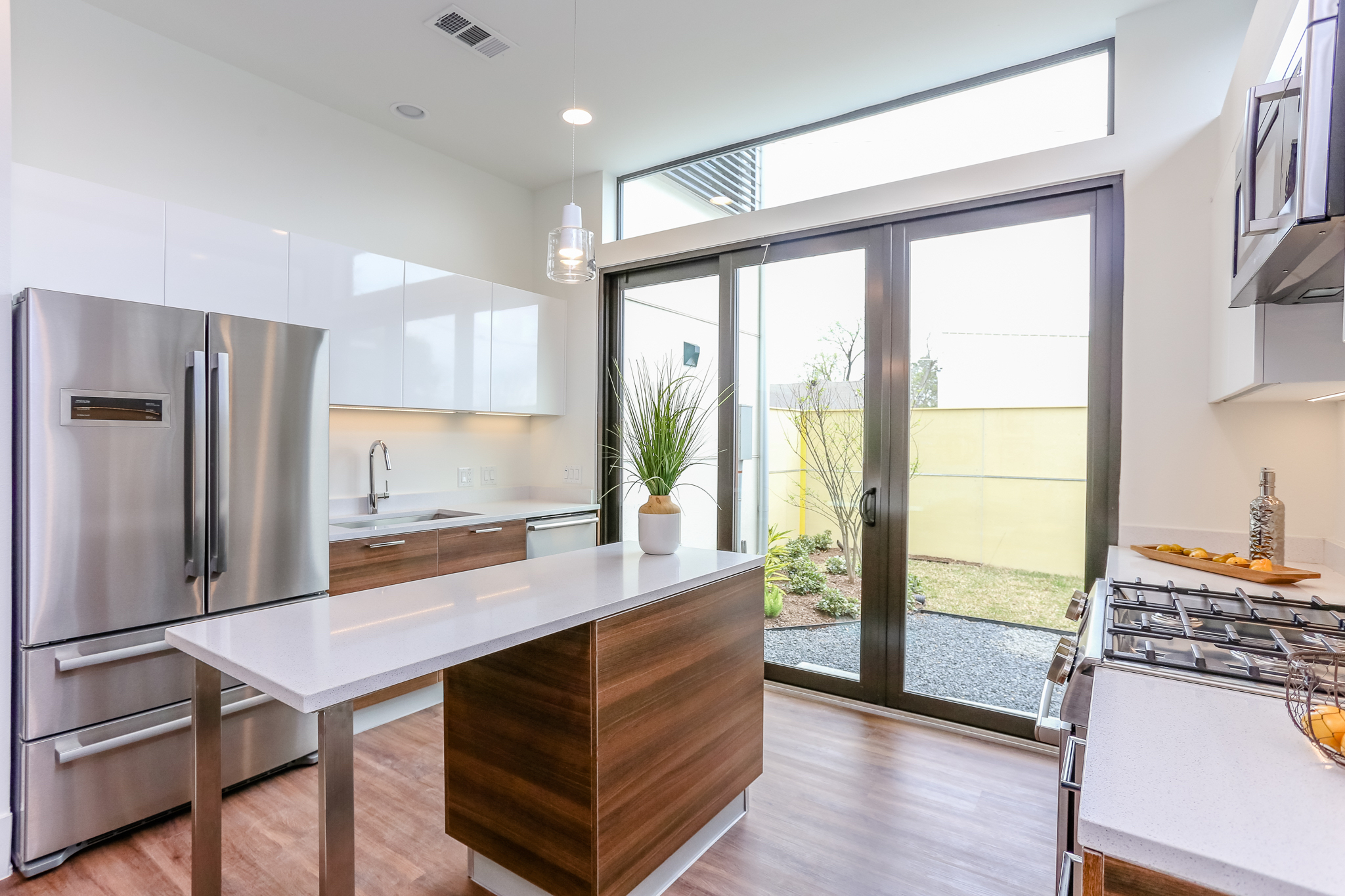 Entertaining is a dream in this ultra-modern kitchen which includes a Bosch stainless steel appliance suite, Moen faucet and sleek Madeval European styled cabinetry with soft-close hinges.