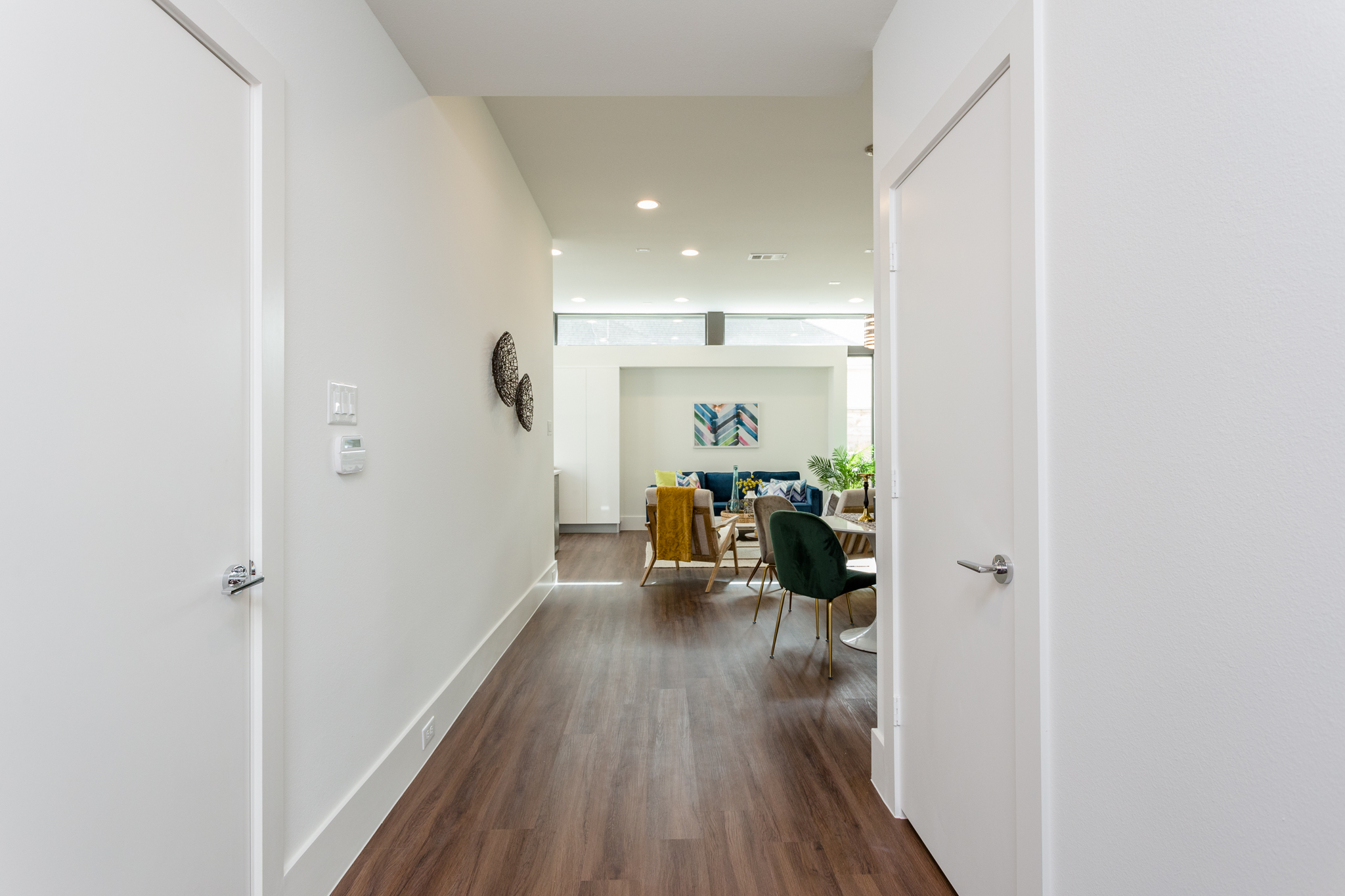 Prepare to be impressed when you enter this polished urban retreat. The door to the attached two-car garage is pictured at left and the discreetly located power room is through the door on the right.