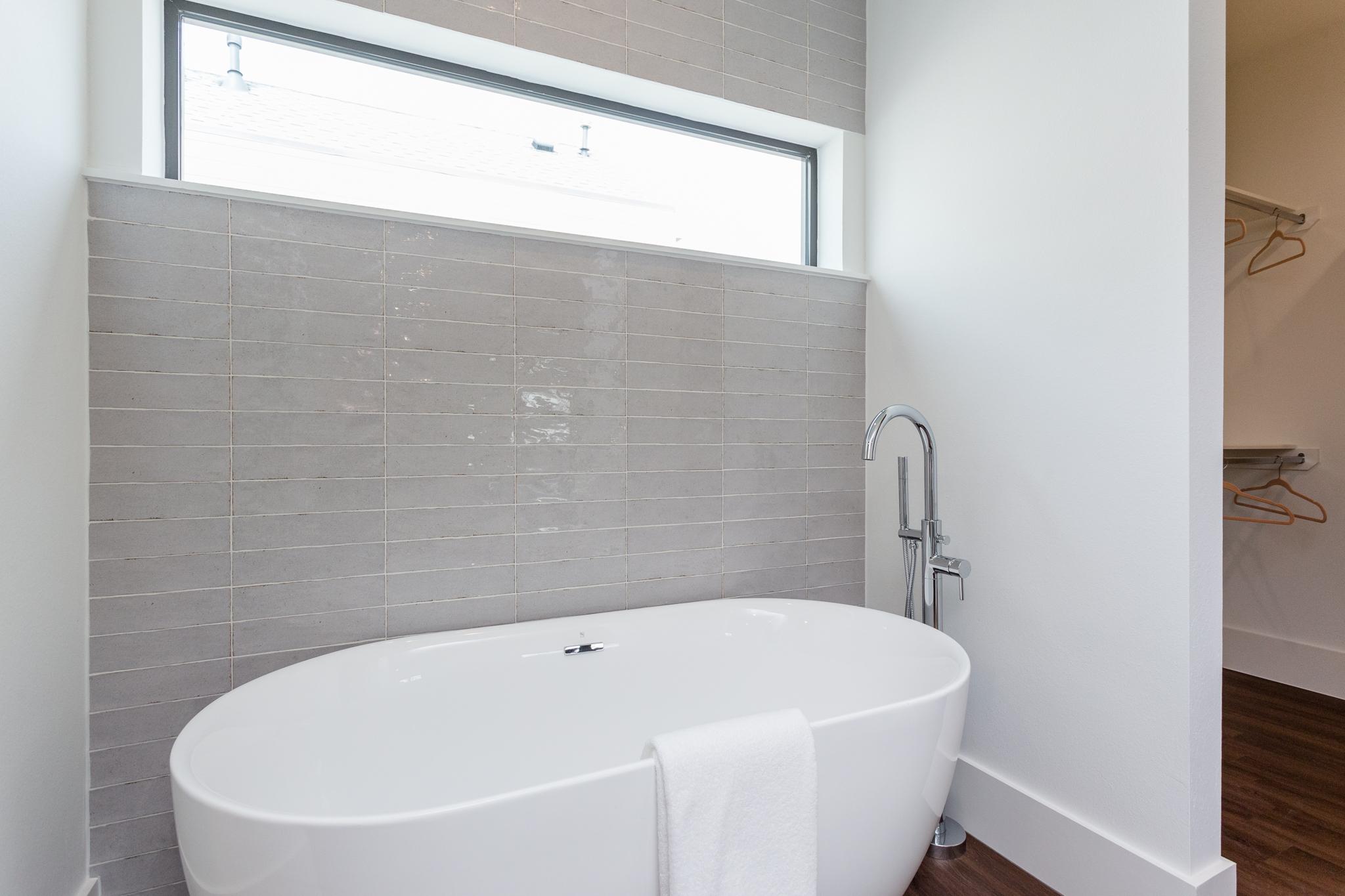 Relax into a contemplative soak in the generous bath.