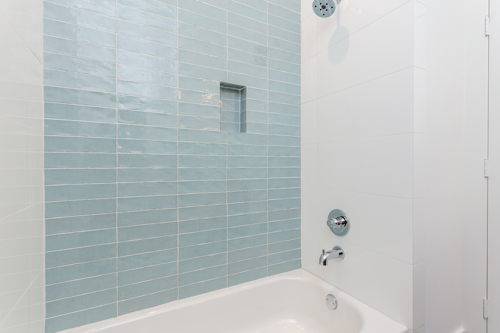 The hall bath is thoughtfully designed with in-wall storage in the tub/shower.