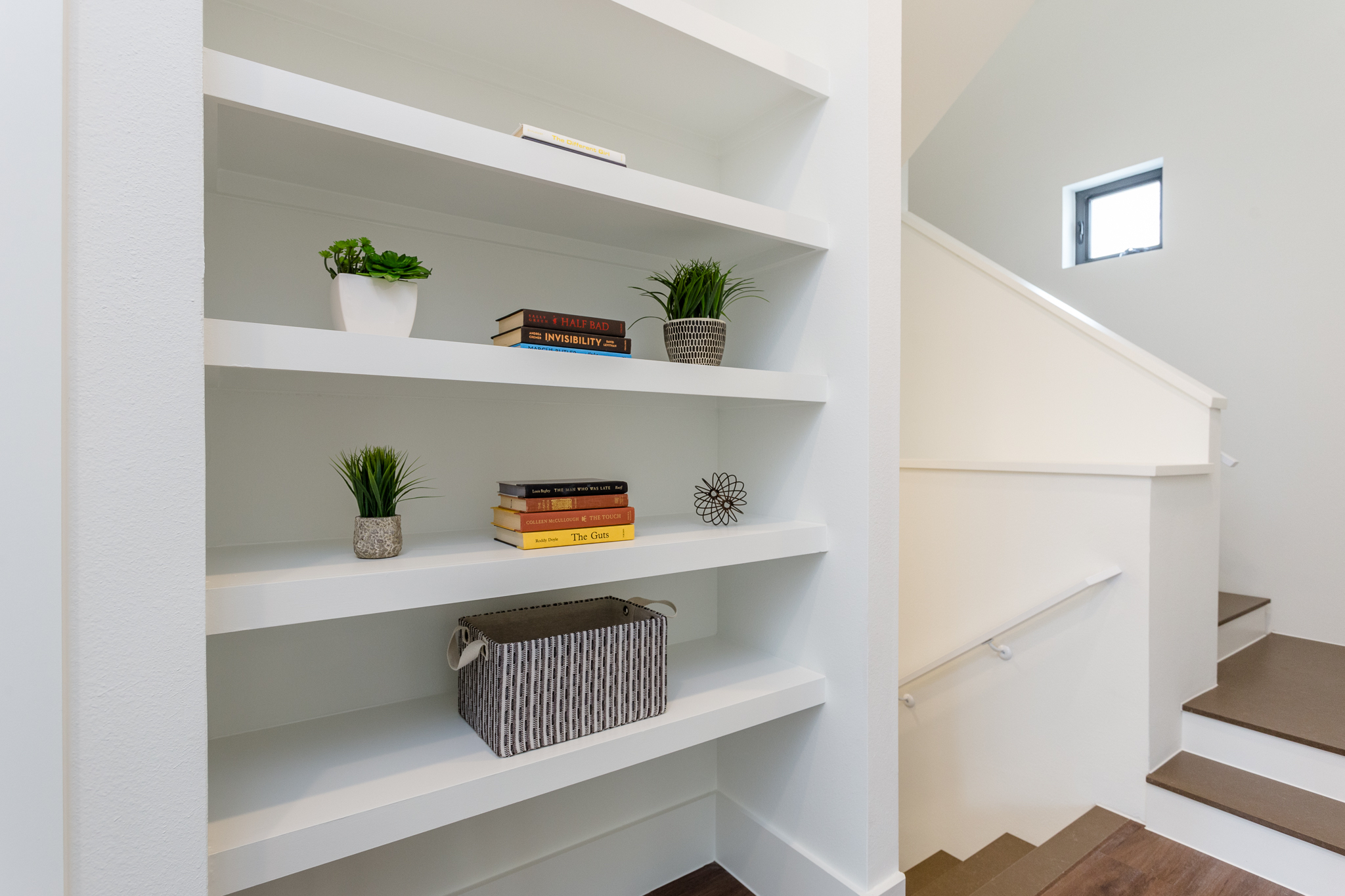 Just outside the bathroom, you'll find stylish shelving.