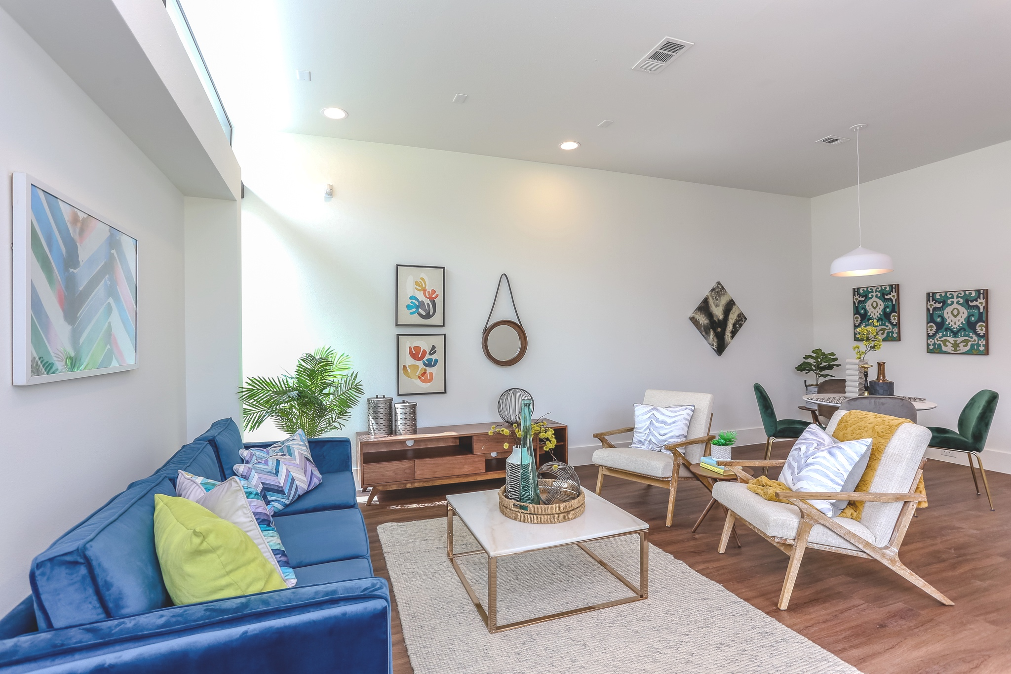 The chic living room features recessed lighting and is pre-wired for surround sounds, cable television, and internet.