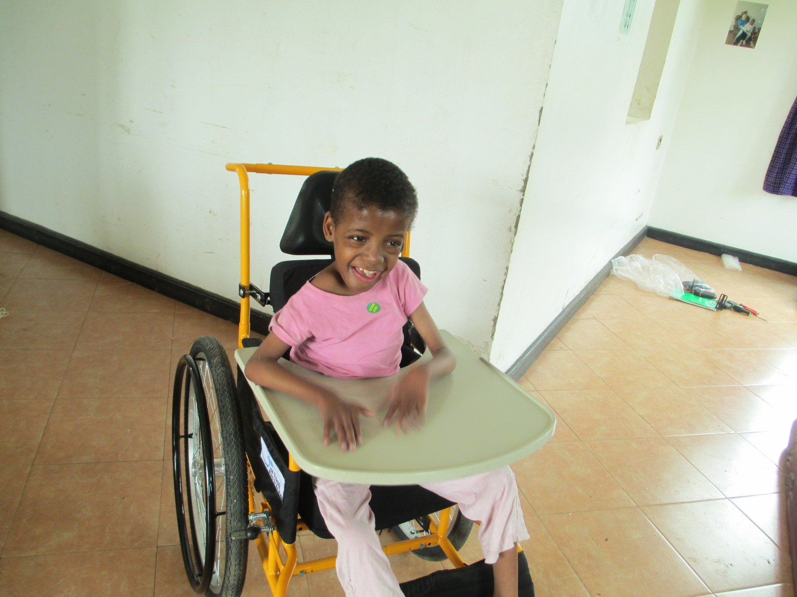 Beatrice who is fifteen years of age is one very happy girl after receiving her very own wheelchair.