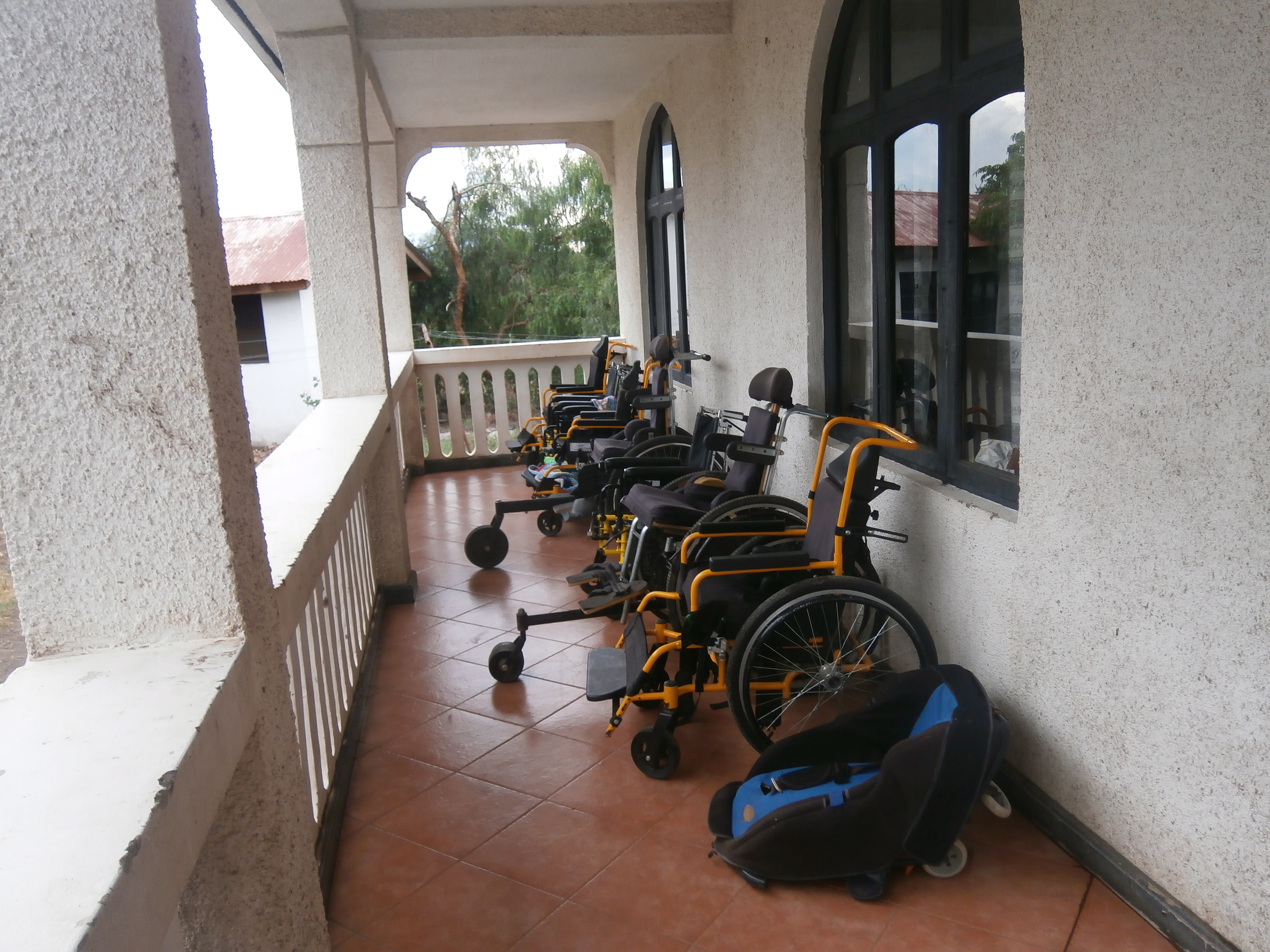 Wheelchairs lined up ready for use. Donated by Joni & Friends