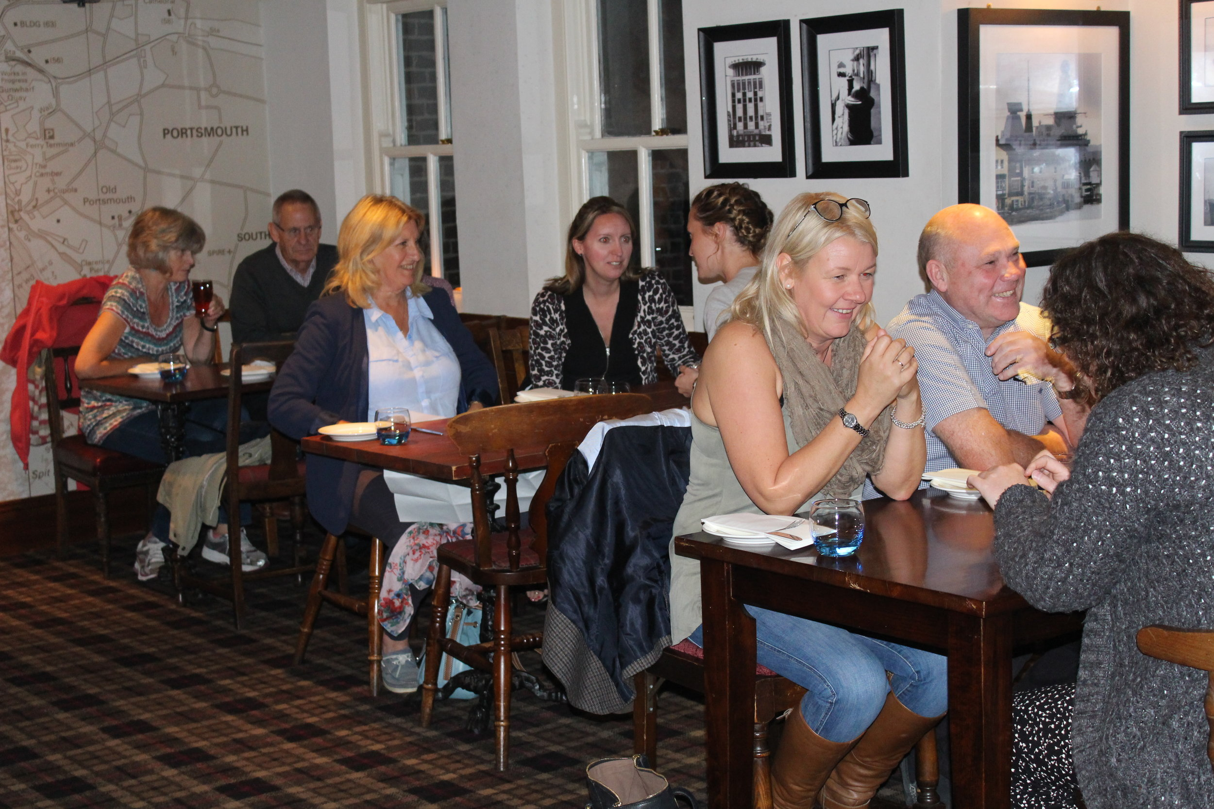 Alumni enjoying a fish and chip supper at the Still & West pub