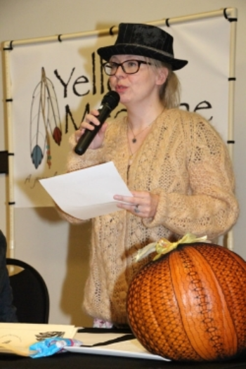 Saara, with pumpkin, reads at the   Marshall Festival 2015.  (Hat and badass co-reader credit:   Kevin Zepper  )