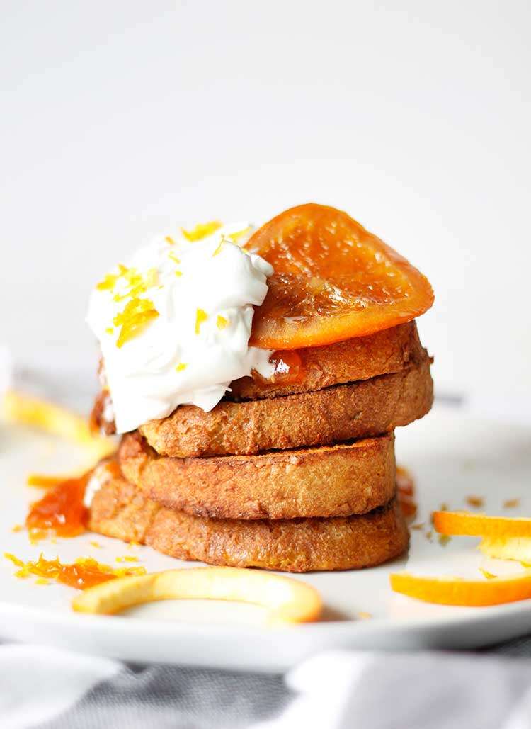 Orange french toast drizzled with orange jam, whipped coconut cream, and candied orange slices. Pure heaven!