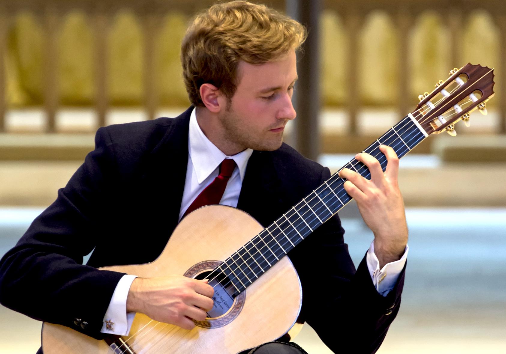 Michael Christian Durrant performing on his Sam McClaren concert guitar