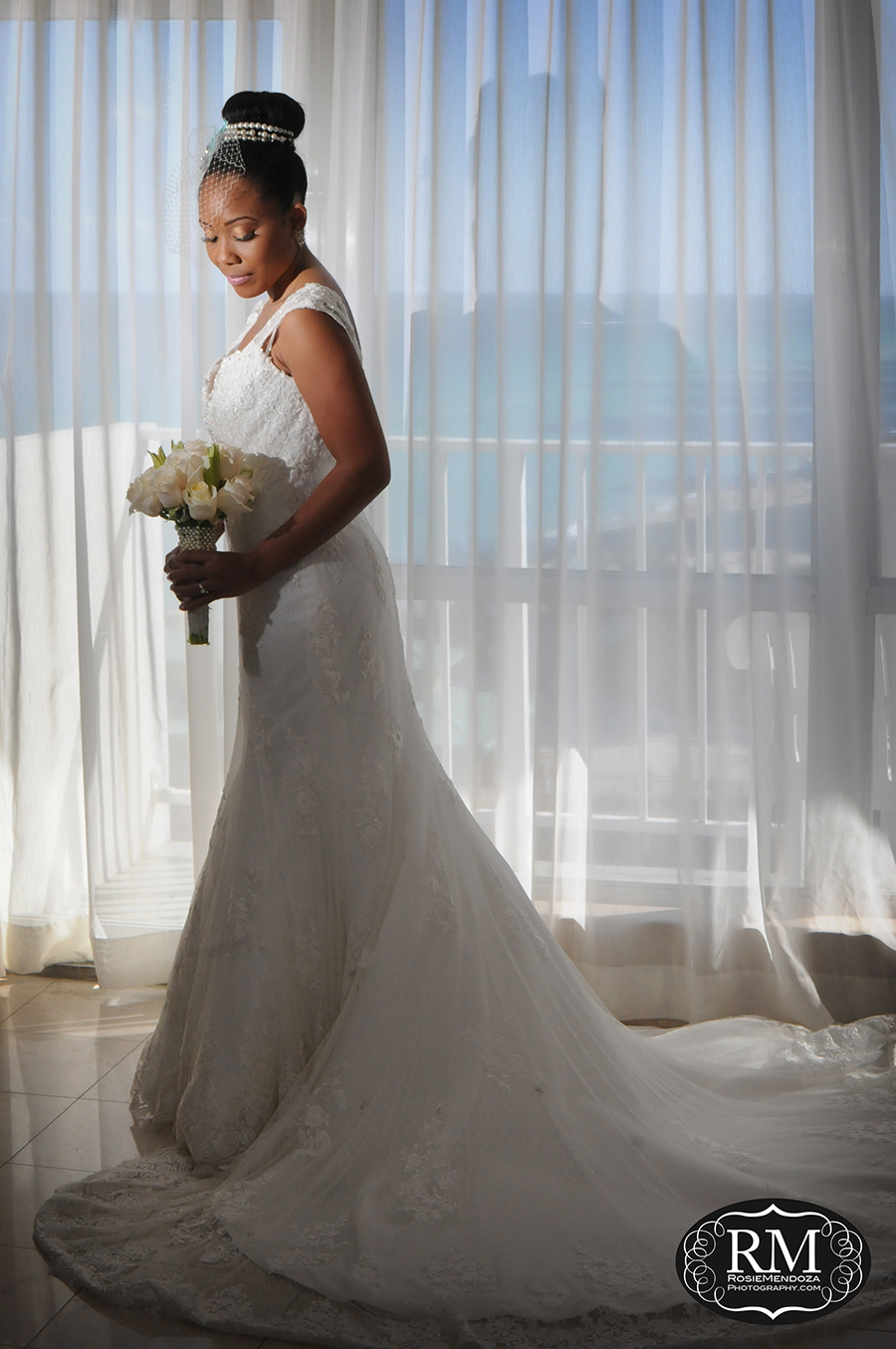 Bride's portrait before walking down the isle, featuring wedding dress and bridal bouquet