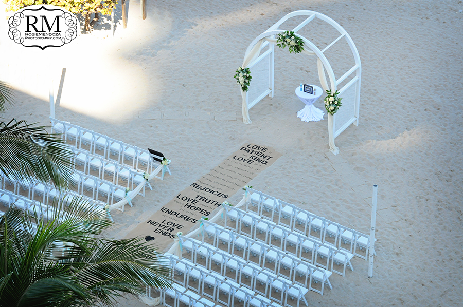 View from bride's room of the beach ceremony setup, featuring their DIY isle runner
