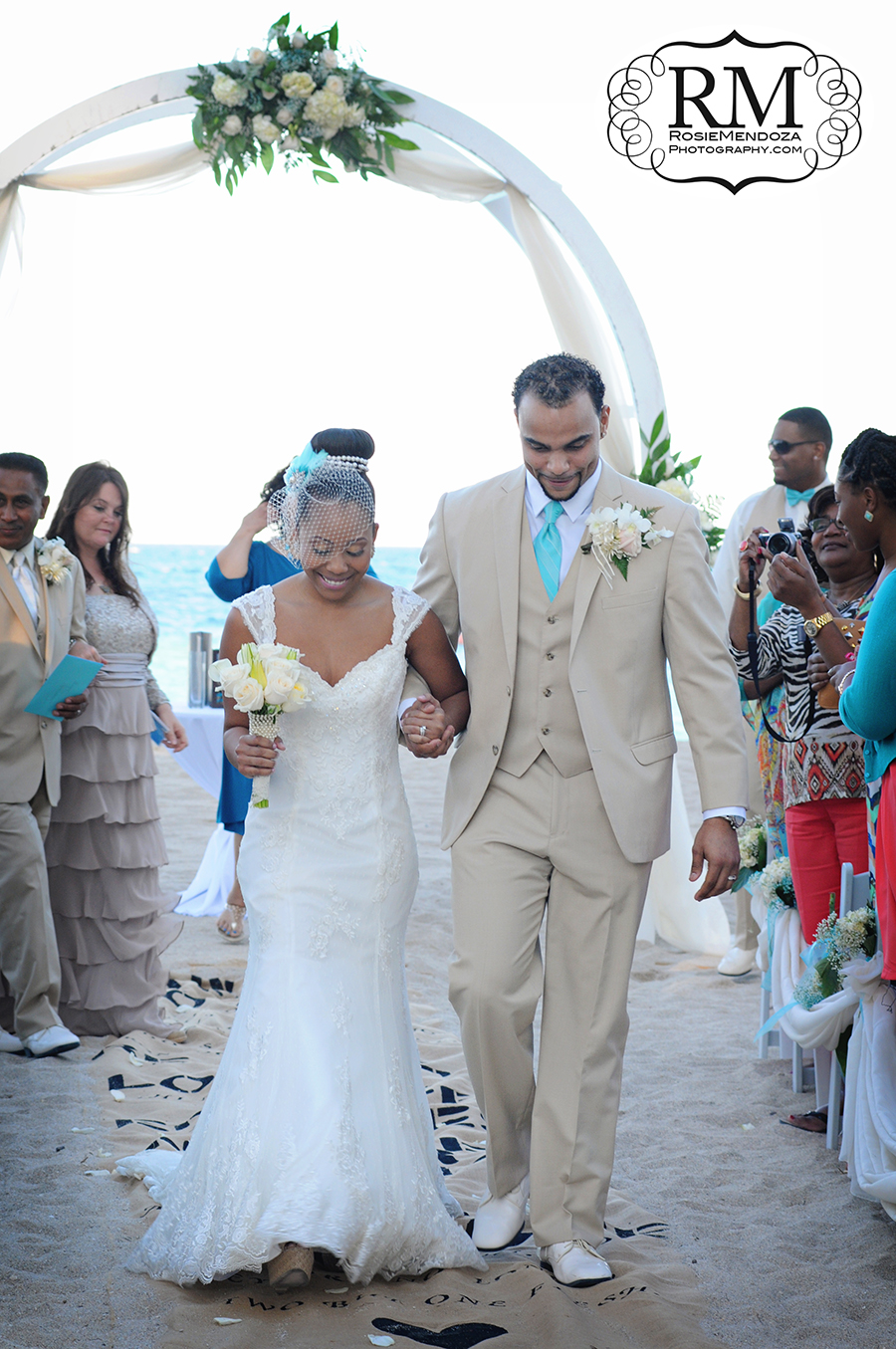 Bride and groom walking away as husband and wife