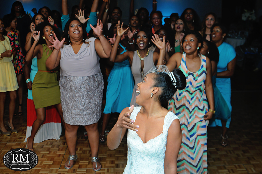 Bride tossing her bouquet to a group of single ladies
