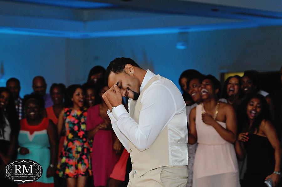 Groom dancing on his way to remove bride's garter