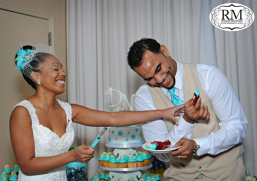 Bride and Groom feeding each other some wedding cupcakes