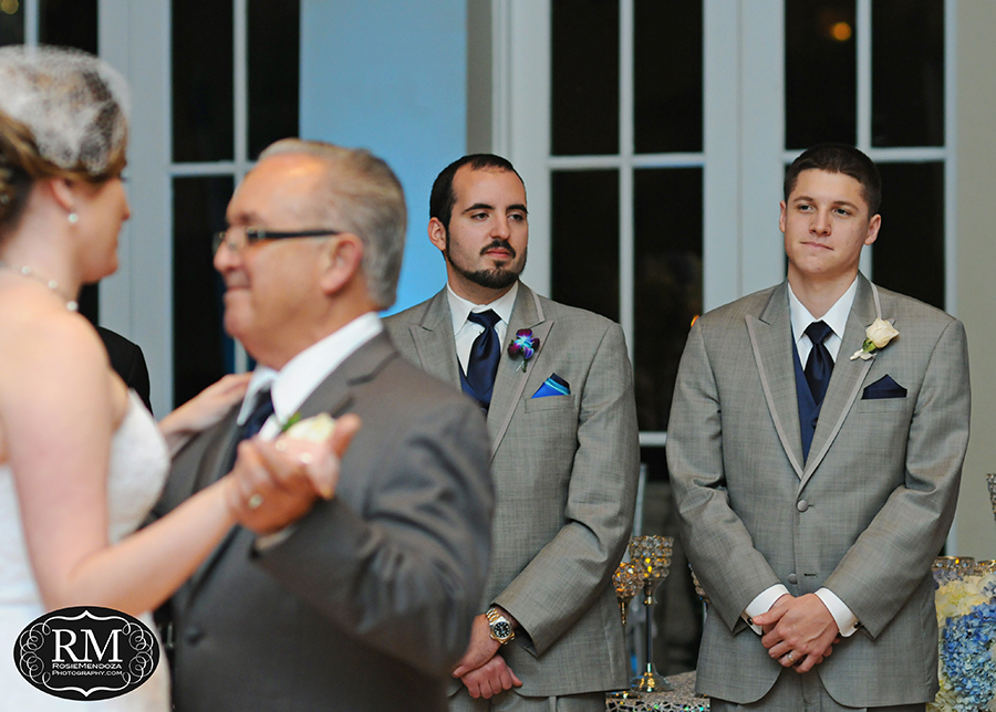 Bride and father first dance under groom's watch