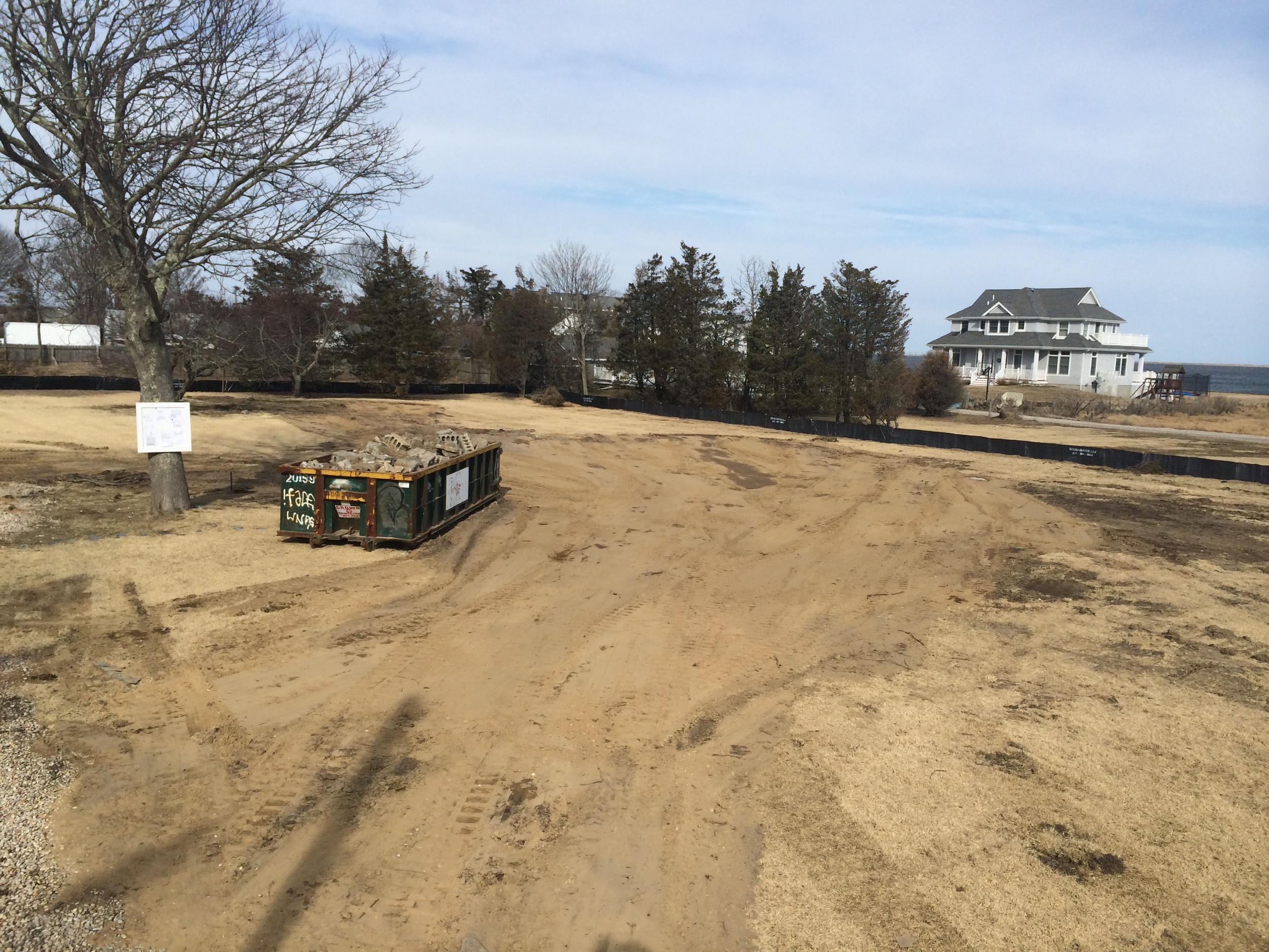 The finished product - an empty lot, graded and ready for construction.  Photo courtesy of Chris Mensch