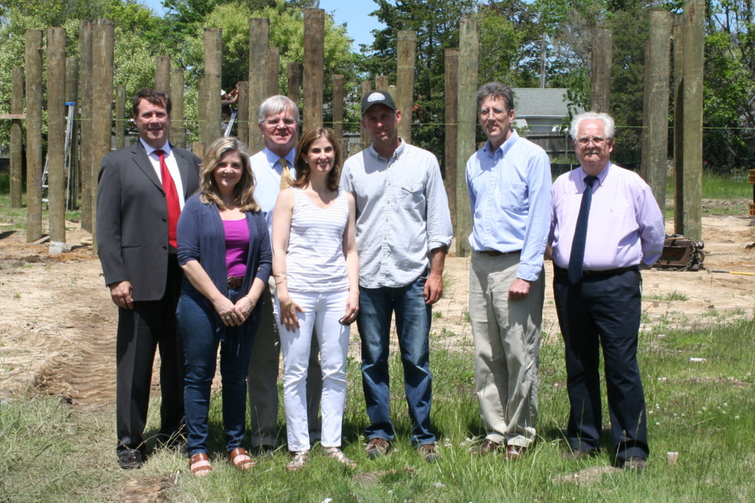 L to R: Greg Blower, Office of New York State Senator Kenneth LaValle; Kathryn Cannon, LEED AP Homes and SGH Project Team Member; New York State Assemblyman Fred W. Thiele, Jr.; Kim Erle, SGH Project Team Leader; Chris Mensch, General Contractor and SGH Project Team Member; Bill Heine, Architect and SGH Project Team Member; Richard Manning, LEED Green Rater and SGH Verification Team Member.