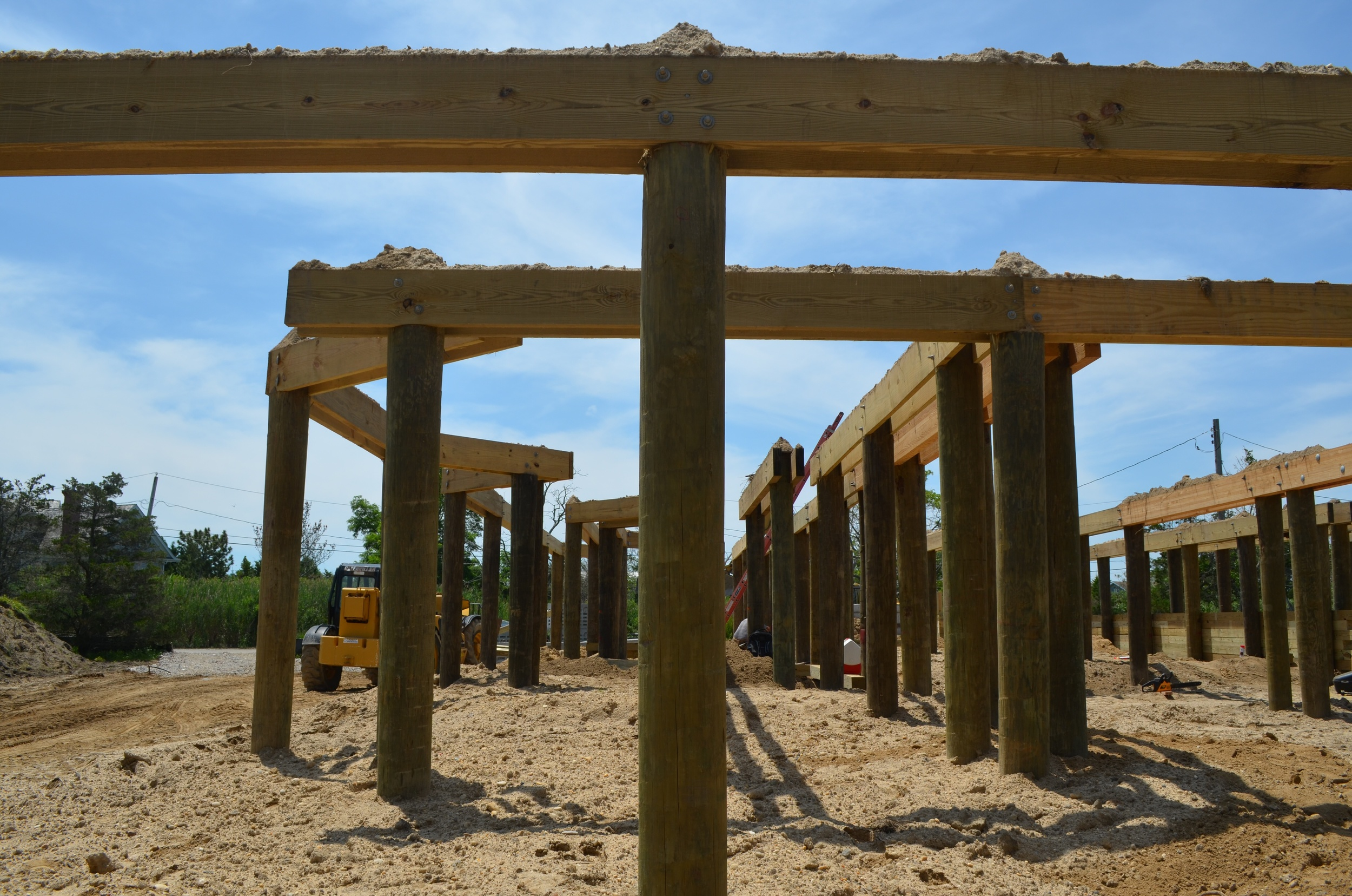 Pilings with power beam cross bracing