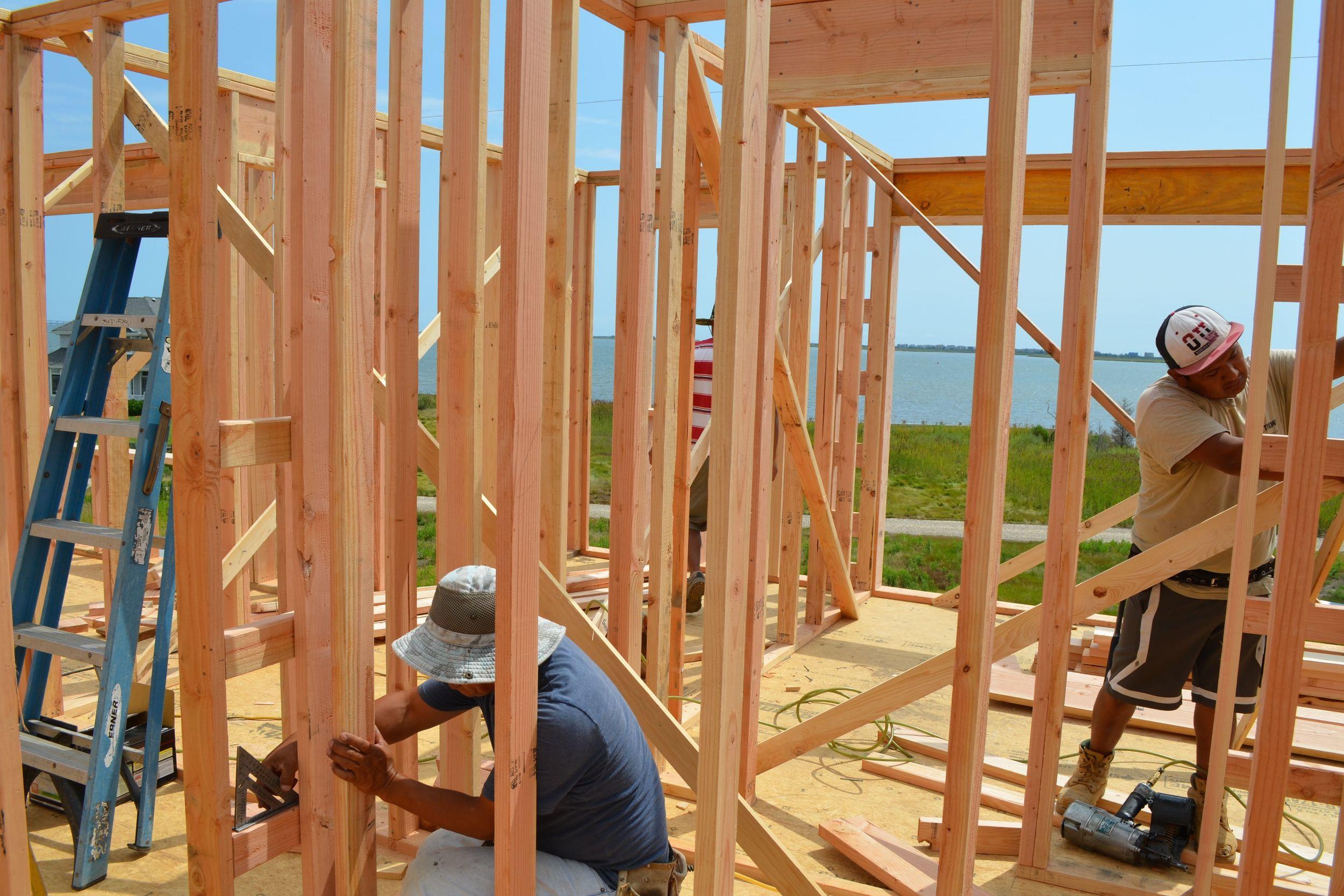 Framing Crew Working on Ladder Blocking