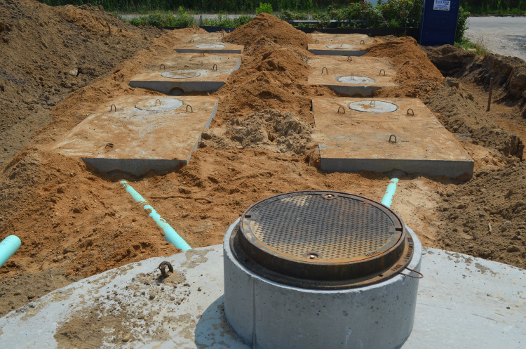 Completed septic system, back-filled and trenched for retaining walls