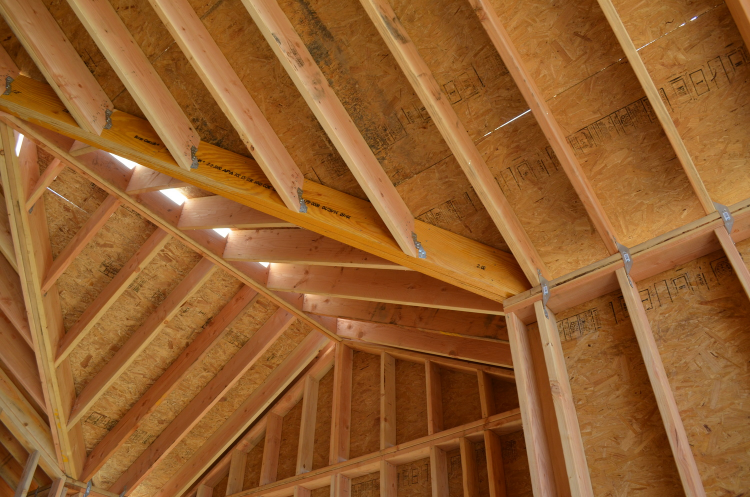 Metal connectors from Simpson Strong Tie help strap the roof to the walls