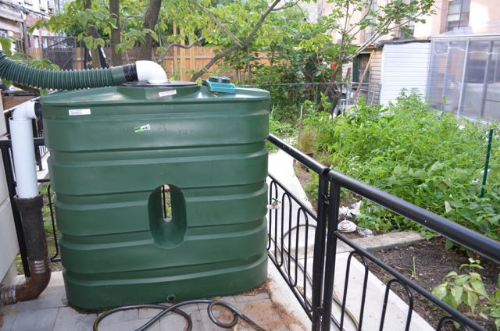 A rainwater harvesting system collects rainwater from 50% of the roof to water the home's sizable vegetable garden